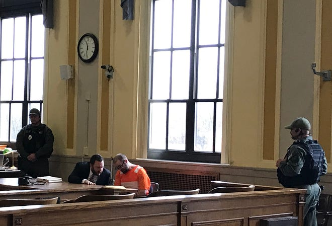 Greg Reinke talks with his attorney while guarded by a prison swat team at the Scioto County Common Pleas Court on Tuesday, Feb. 12, 2019. Reinke is facing attempted murder charges for two incidents while in the Southern Ohio Correctional Facility.