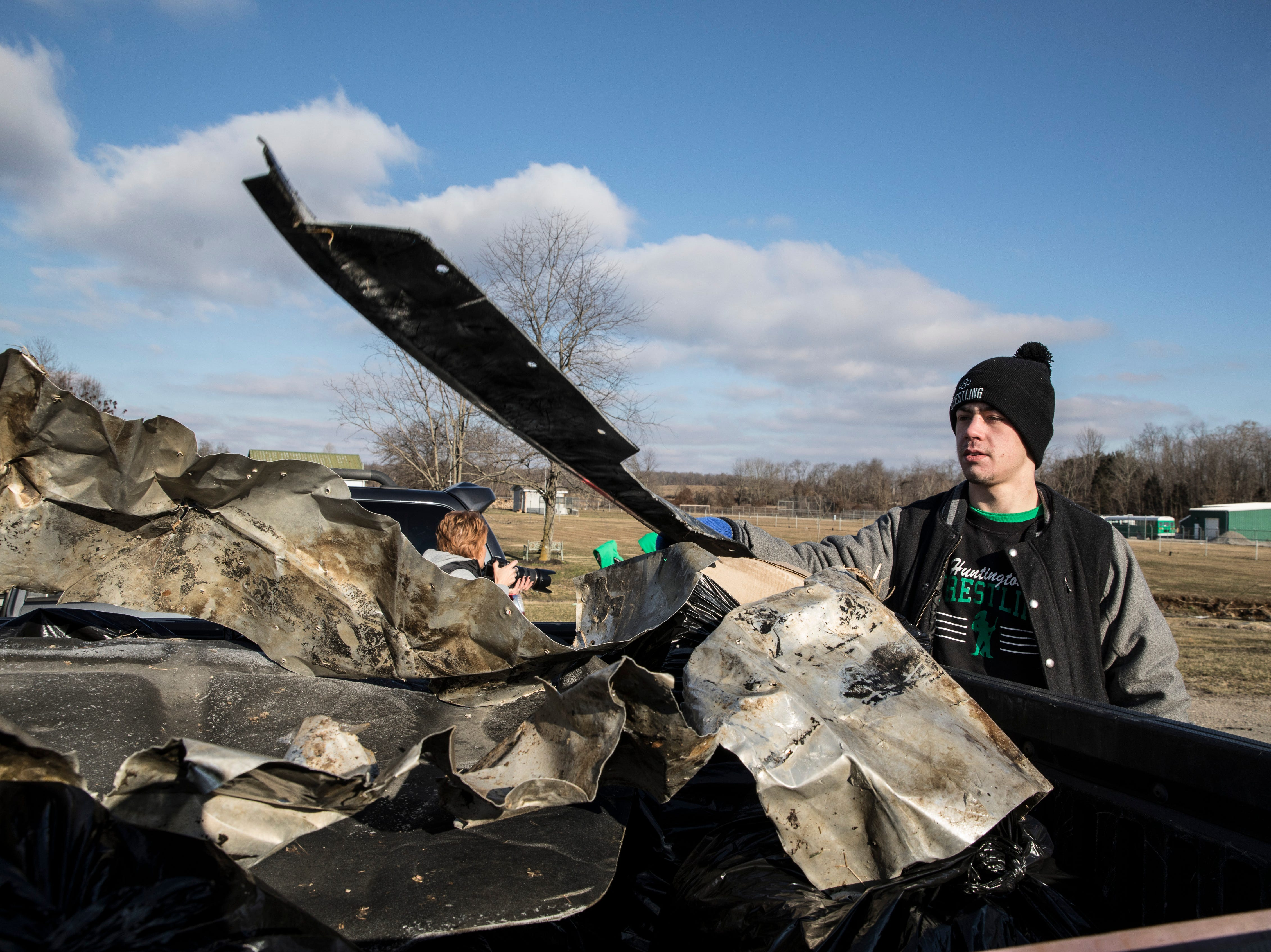 Several members of the Huntington wrestling team spent their Saturday morning volunteering to clean trash and debris from the side of OH 772 near Huntington High School and some of its surrounding roads.