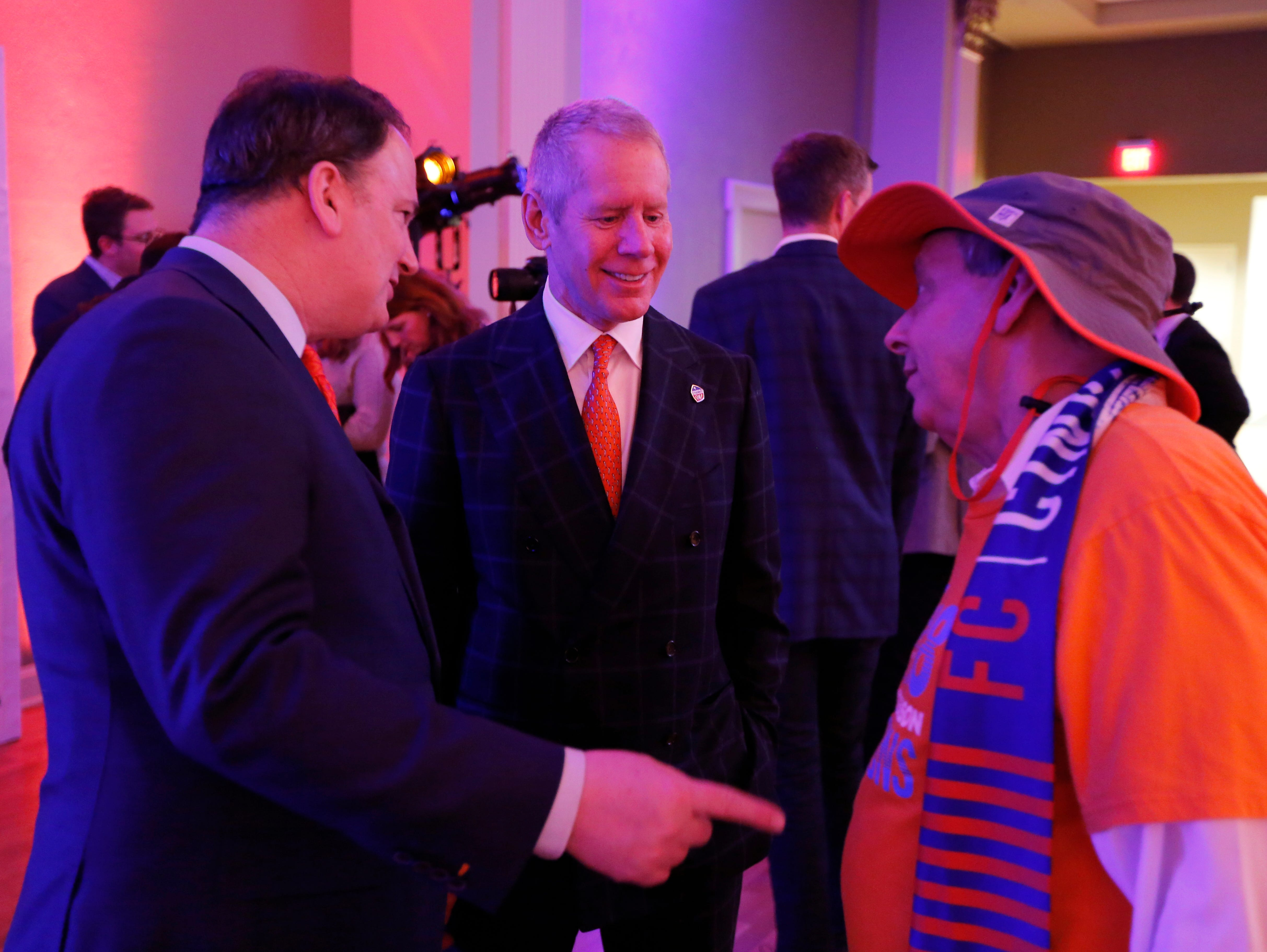 Team general manager Jeff Berding and owner Carl Lindner III talk with fans during an event to unveil FC Cincinnati's jersey for the team's inaugural season in Major League Soccer at the Music Hall Ballroom in the Over-the-Rhine neighborhood of Cincinnati on Monday, Feb. 11, 2019.