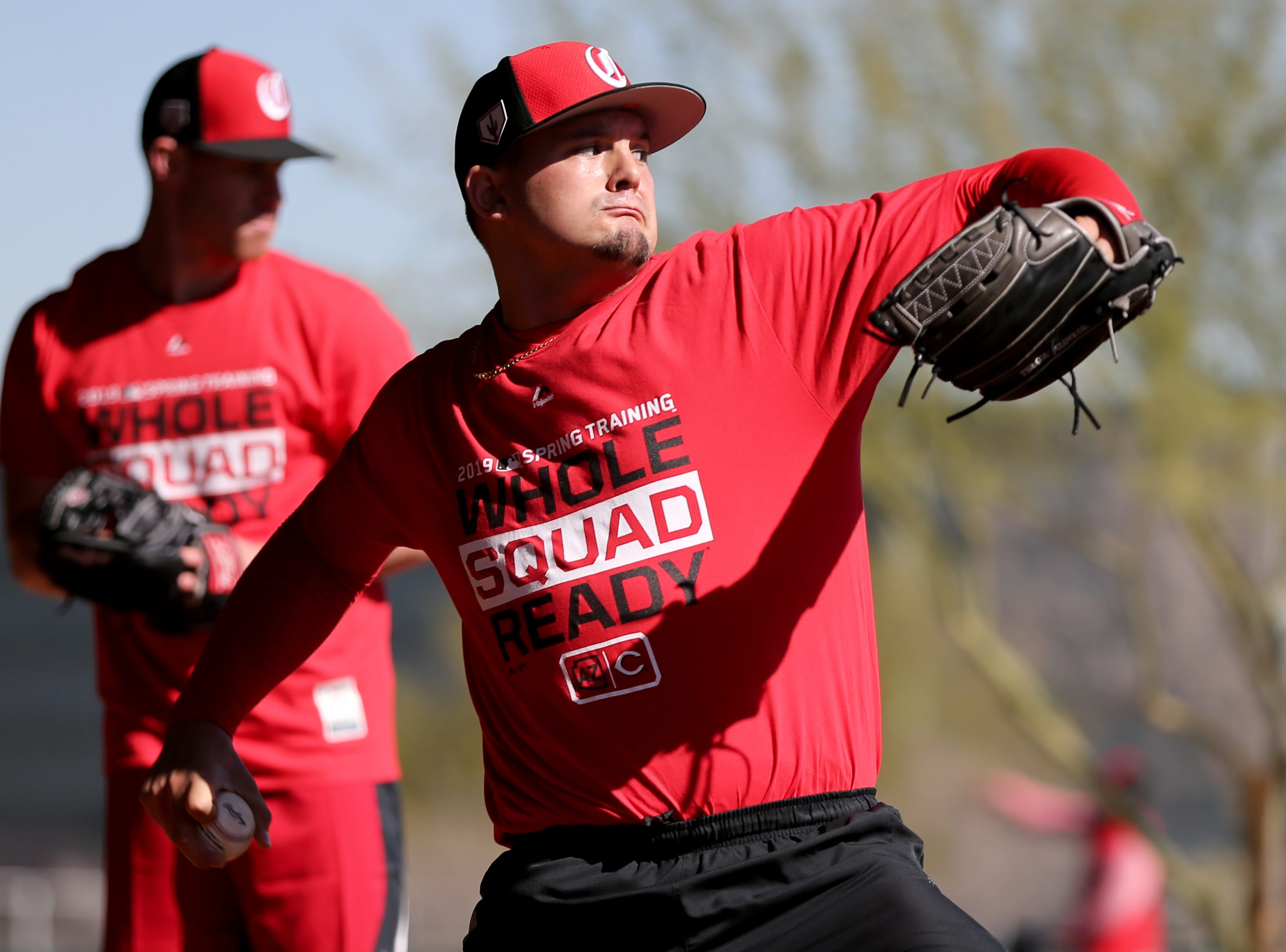 Cincinnati Reds pitcher Sal Romano delivers as he throws in the bullpen on report day for pitchers and catchers, Tuesday, Feb. 12, 2019, at the Cincinnati Reds spring training facility in Goodyear, Arizona.