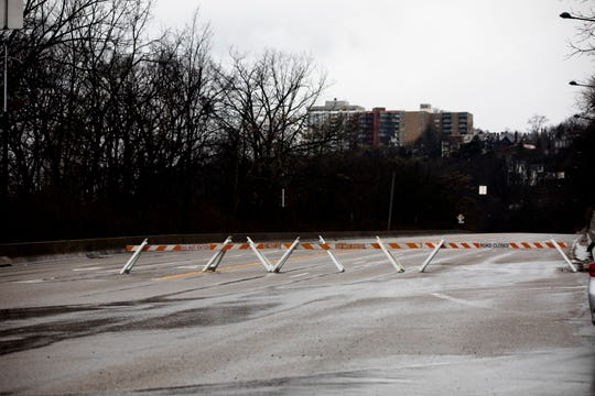 Road blocks sit on Columbia Parkway at William Taft Road in Cincinnati on Tuesday, Feb. 12, 2019.