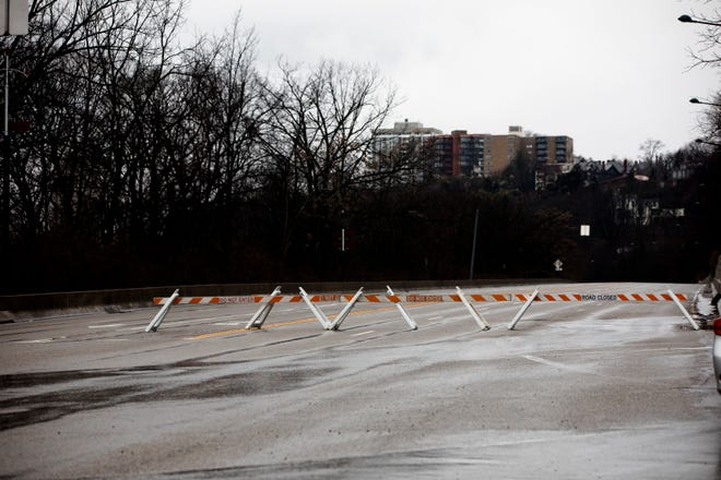 Road blocks sit on Columbia Parkway at William Taft Road in Cincinnati on Tuesday, Feb. 12, 2019.
