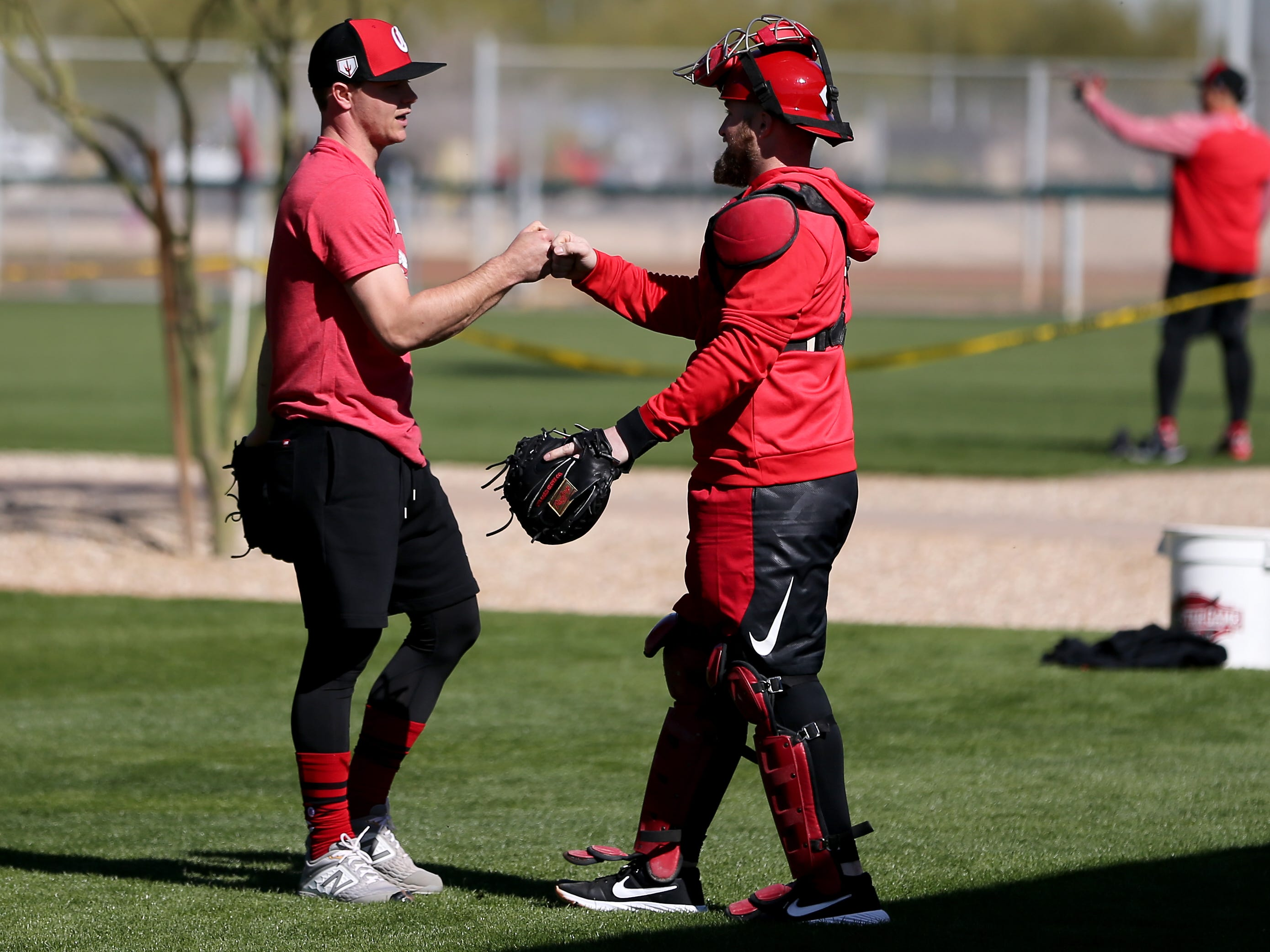 Cincinnati Reds pitchers and catchers participate in informal workouts on report day, Tuesday, Feb. 12, 2019, at the Cincinnati Reds spring training facility in Goodyear, Arizona.