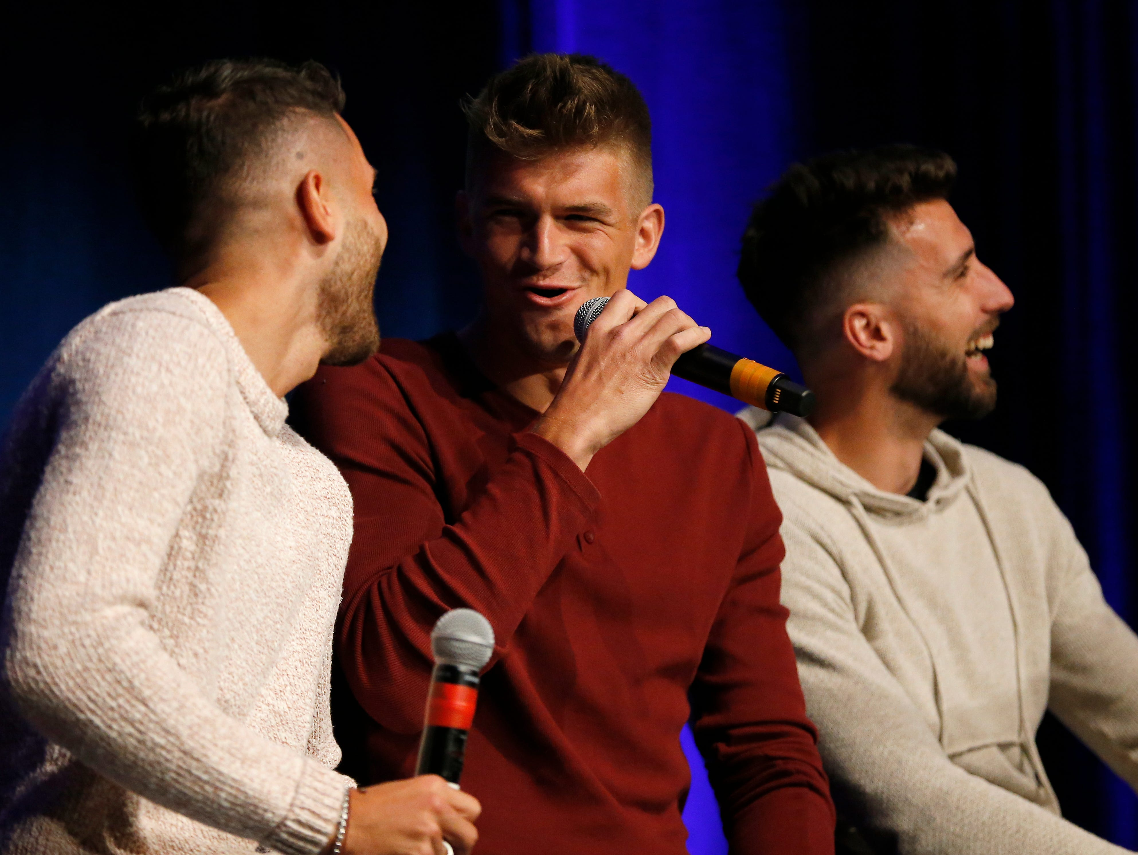 Nick Hagglund laughs with teammate Greg Garza during an event to unveil FC Cincinnati's jersey for the team's inaugural season in Major League Soccer at the Music Hall Ballroom in the Over-the-Rhine neighborhood of Cincinnati on Monday, Feb. 11, 2019.