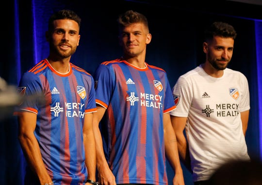 Player representatives take the stage in new primary and secondary jerseys during an event to unveil FC Cincinnati's jersey for the team's inaugural season in Major League Soccer at the Music Hall Ballroom in the Over-the-Rhine neighborhood of Cincinnati on Monday, Feb. 11, 2019.