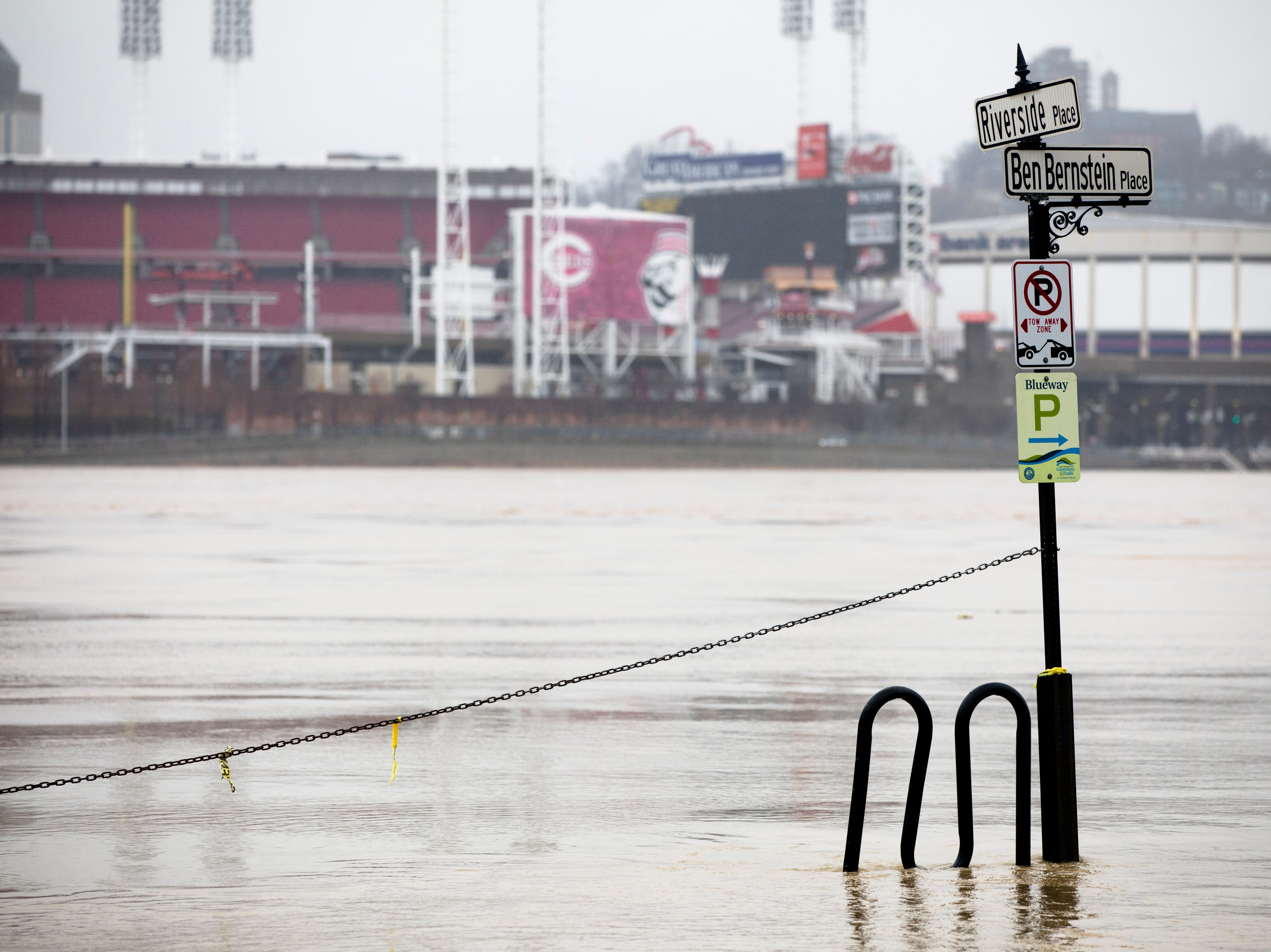 The Ohio River floods the intersection at Riverside Place and Ben Bernstein Place in Covington on Tuesday, Feb. 12, 2019. The Ohio River is expected to crest at 56.3 feet at 1 a.m. Wednesday, Feb. 13.