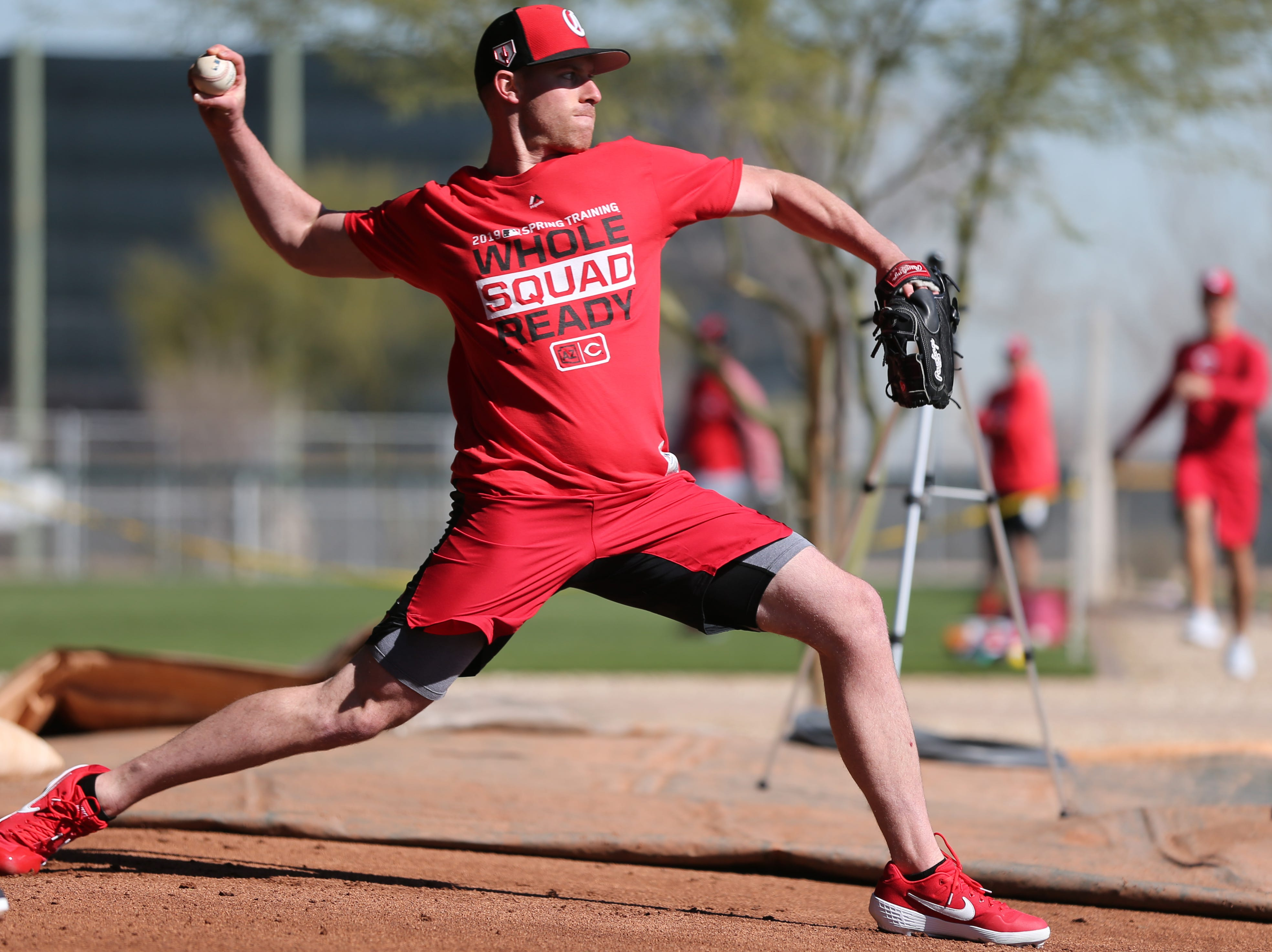 Cincinnati Reds pitcher Anthony DeSclafani delivers as he throws in the bullpen on report day for pitchers and catchers, Tuesday, Feb. 12, 2019, at the Cincinnati Reds spring training facility in Goodyear, Arizona.