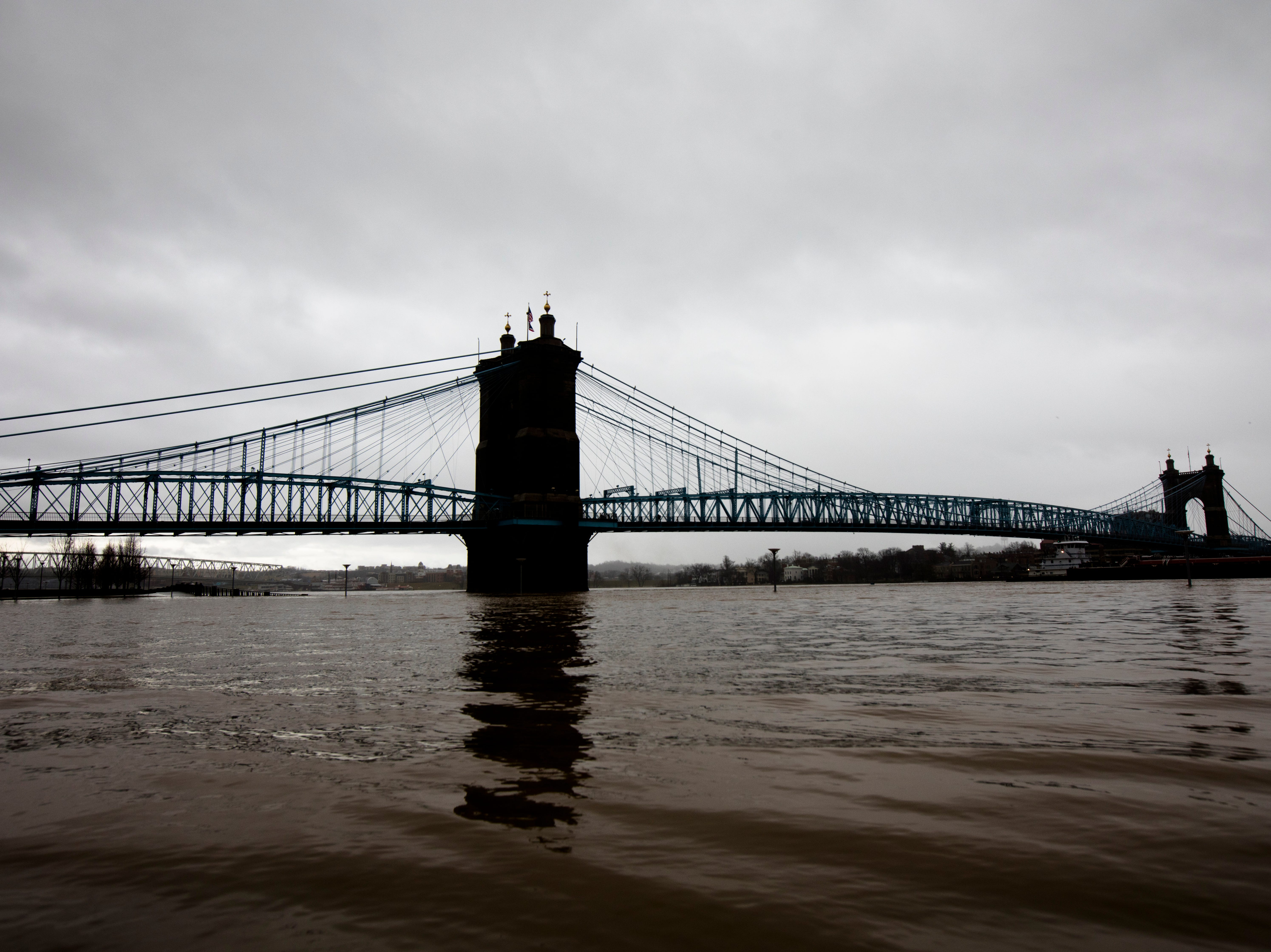 A view of the Roebling Bridge in Cincinnati on Tuesday, Feb. 12, 2019. The Ohio River is expected to crest at 56.3 feet at 1 a.m. Wednesday, Feb. 13.