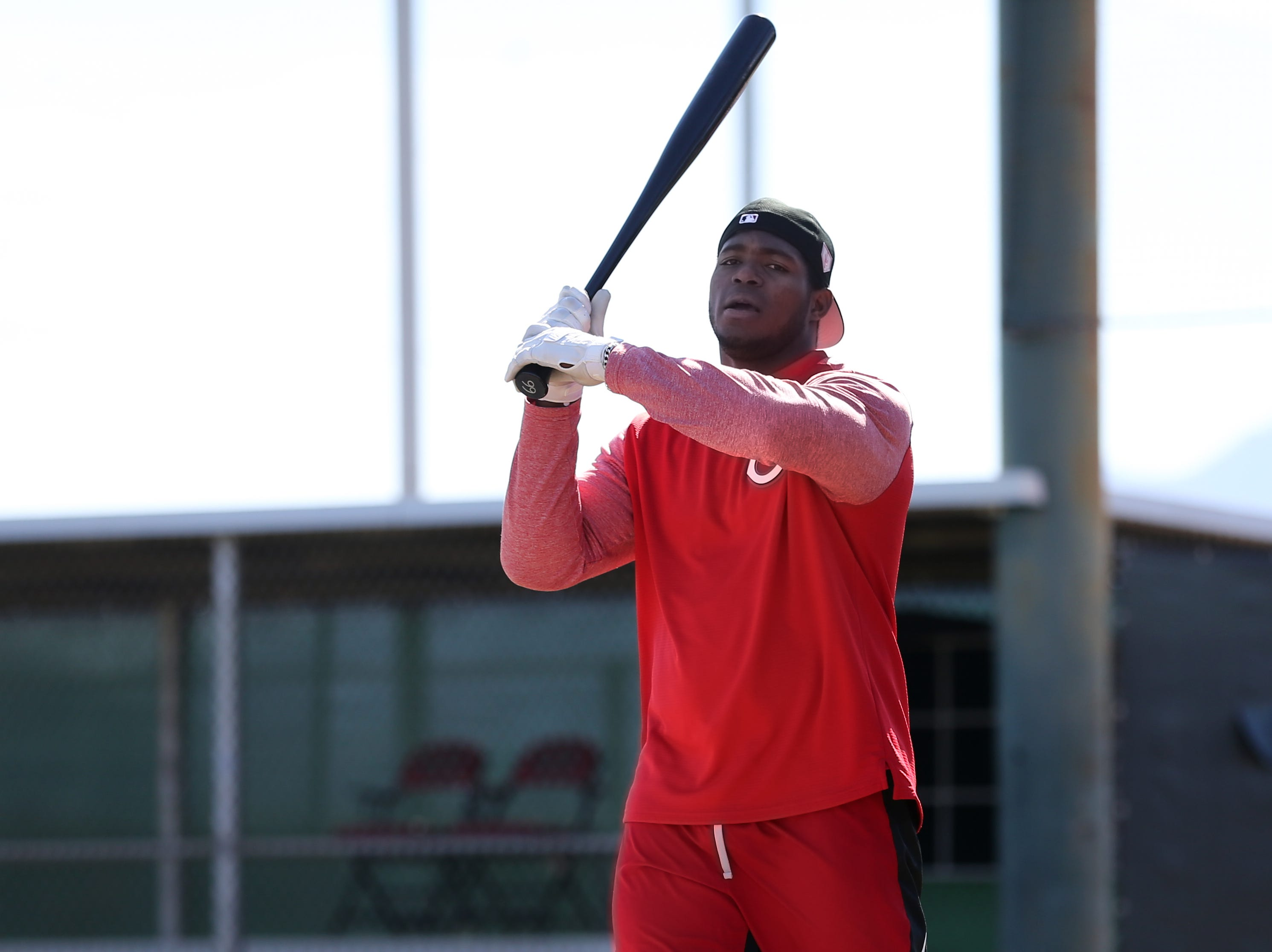 Cincinnati Reds outfielder Yasiel Puig steps to the plate for batting practice on report day for pitchers and catchers, Tuesday, Feb. 12, 2019, at the Cincinnati Reds spring training facility in Goodyear, Arizona.