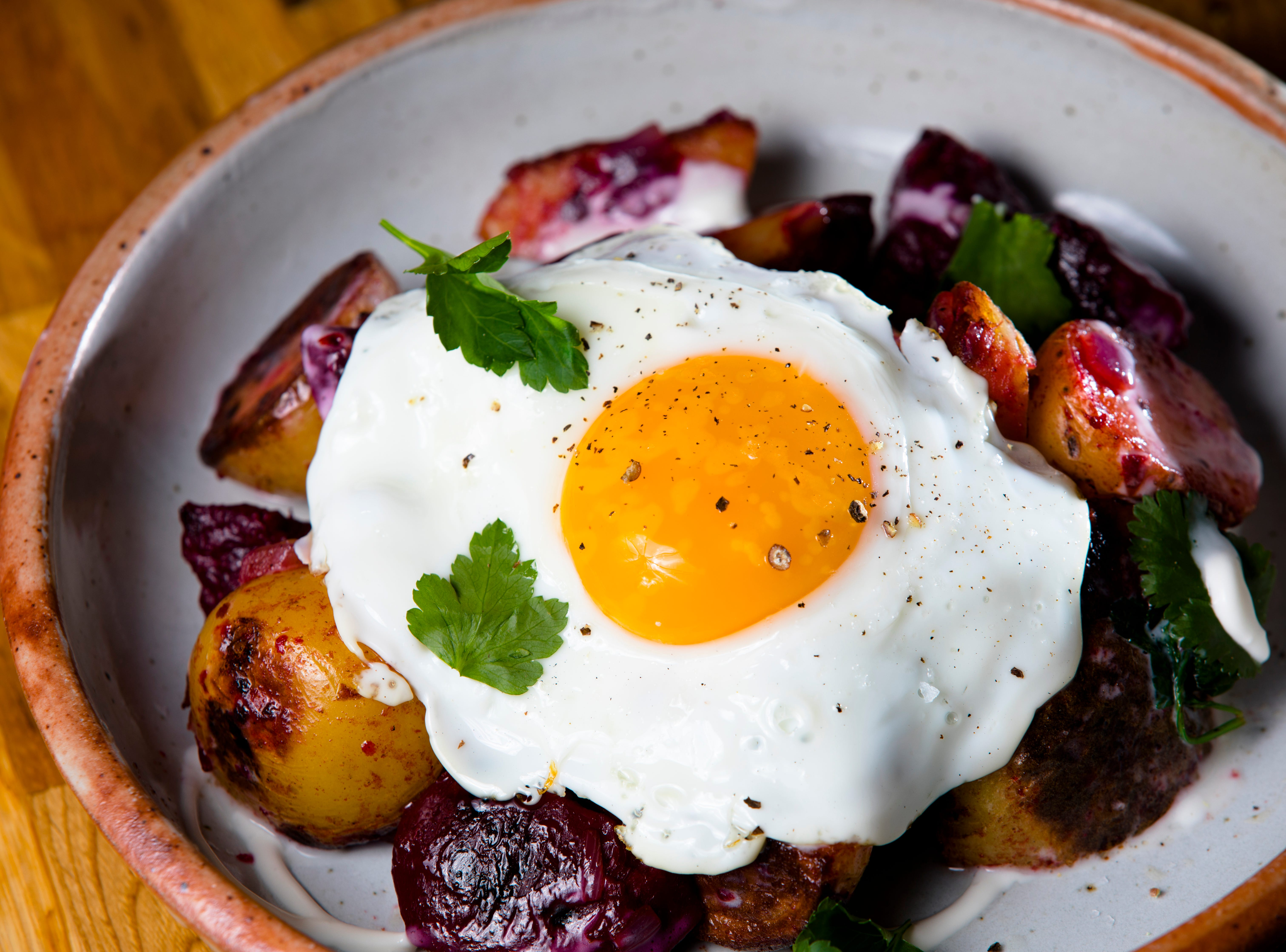 Red Flannel hash with creme fraiche and a fried farm egg at The Bakers' Table in Newport, Ky., on Tuesday, Feb. 12, 2019.