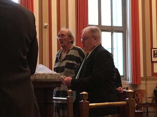 Jerry Hinkle, wearing a jail uniform, stands next to his attorney,  David Clodfelter, at his sentencing Tuesday in Hamilton County Common Pleas Court.
