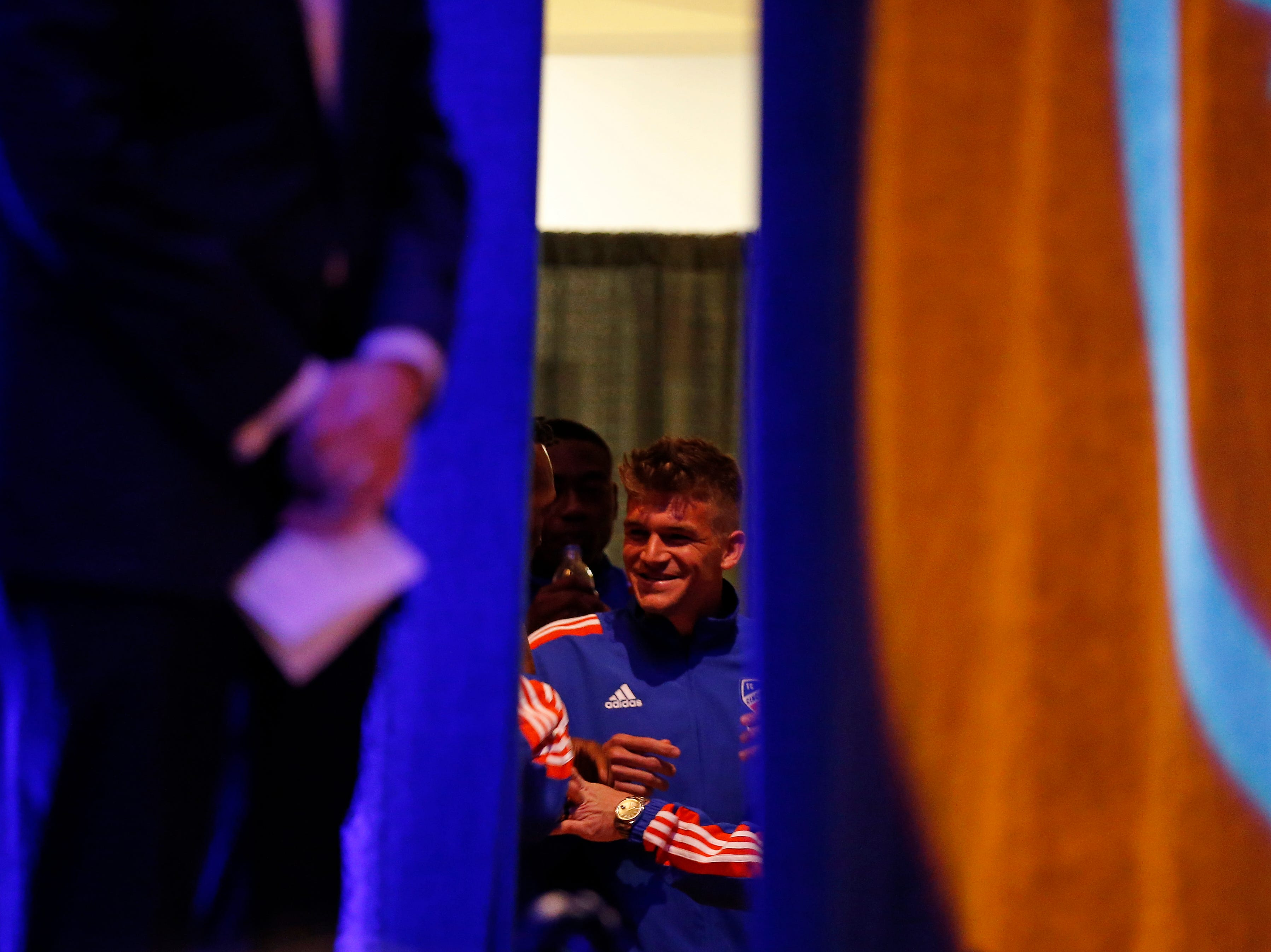 Player representatives laugh back stage before being introduced during an event to unveil FC Cincinnati's jersey for the team's inaugural season in Major League Soccer at the Music Hall Ballroom in the Over-the-Rhine neighborhood of Cincinnati on Monday, Feb. 11, 2019.