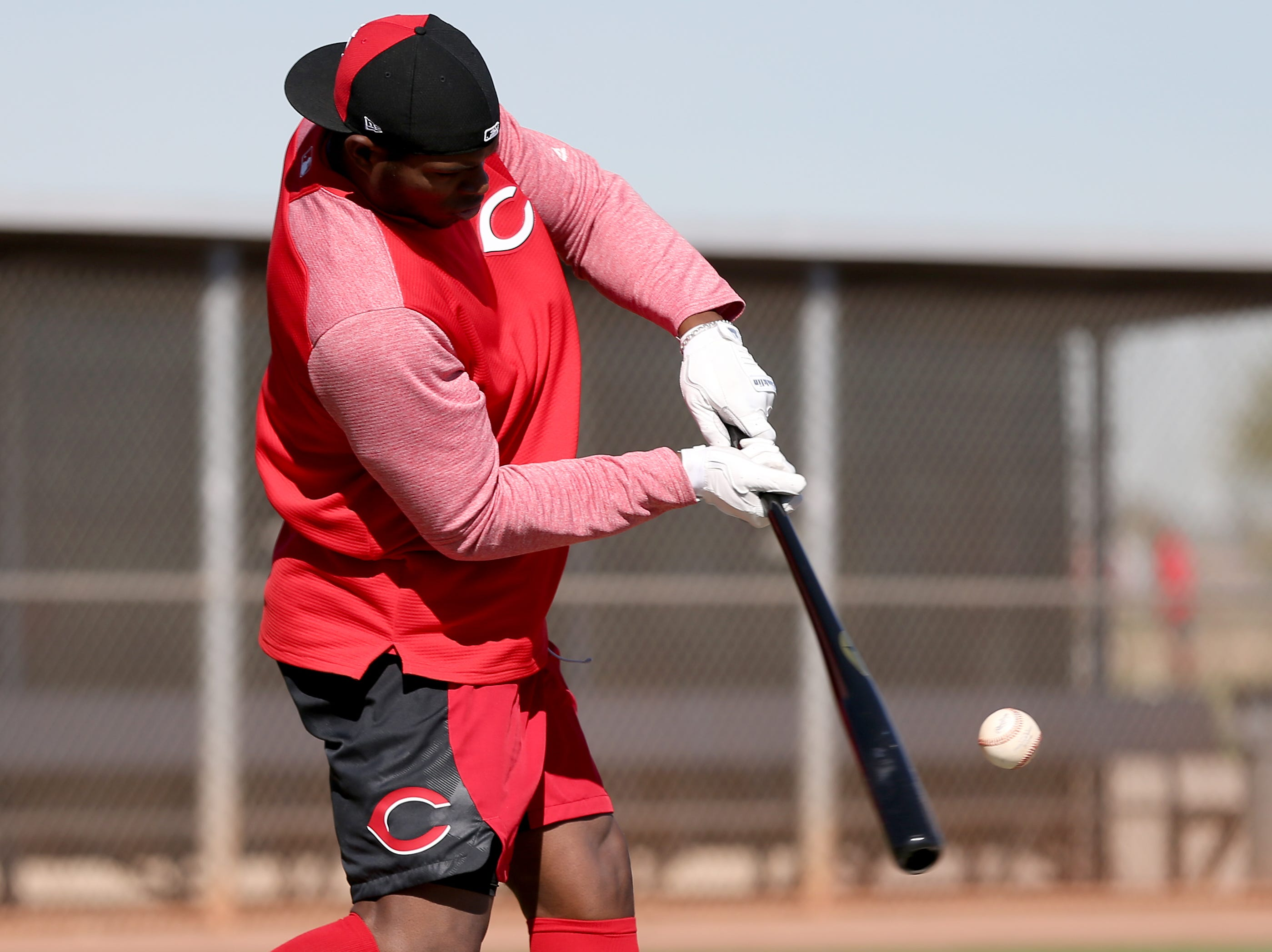 Cincinnati Reds outfielder Yasiel Puig swings during batting practice on report day for pitchers and catchers, Tuesday, Feb. 12, 2019, at the Cincinnati Reds spring training facility in Goodyear, Arizona.