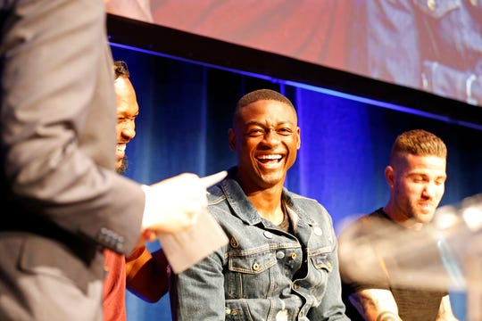 Fanendo Adi laughs as he's interview on stage during an event to unveil FC Cincinnati's jersey for the team's inaugural season in Major League Soccer at the Music Hall Ballroom in the Over-the-Rhine neighborhood of Cincinnati on Monday, Feb. 11, 2019.
