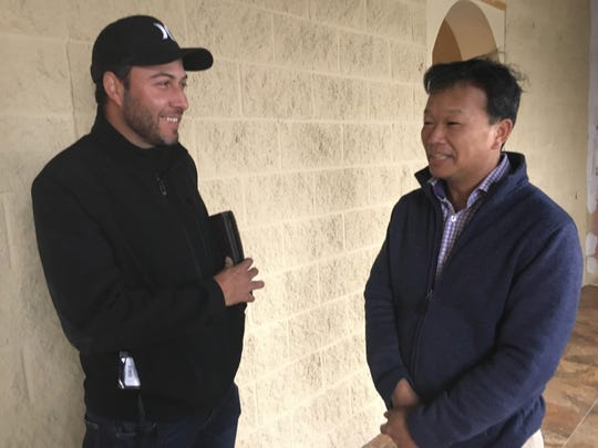 El Rancho Grande Mexican Restaurant co-owner Luis Caratachea, left, visits with building owner James Lung at the newly-remodeled Exit 11 restaurant.