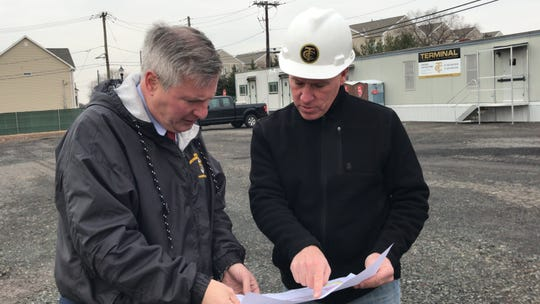 Piscataway Mayor Brian C. Wahler discusses the plans for the soon-to-be-built Community and Cultural Center on Hoes Lanes with Terminal Project Manager Michael Allegretta. The $32 million project largely is being funded by revenue generated from several redevelopment projects in the township.