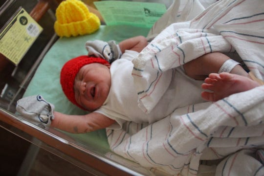 "The American Heart Association (AHA) and The Children's Heart Foundation recently launched the fourth year of the state's ""Little Hats, Big Hearts"" initiative. Capital Health newborn babies are wearing their red caps."