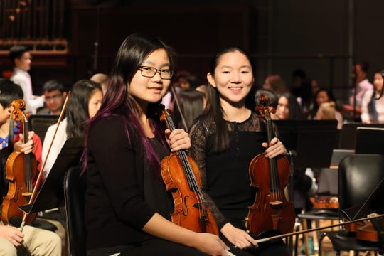 Felicia Ho (on the right) from one of Pingry's winter festival concerts.