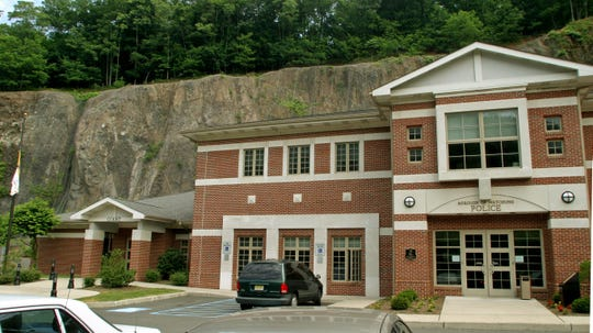 A Hillside woman has been charged with kicking and destroying a computer screen at Watchung Police Headquarters.