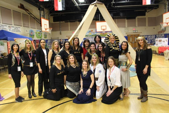 Members of the Angelo L. Tomaso School/ PTO. Front row left to right: Shawna Slater, Jessica Bodajlo, Kami Nelson, Amanda Beyus, Christine Brezee Back row left to right: Zeina Jundi, Vivian Shehady, Kruti Rumani, Arelis Buzzerio, Michele Araujo, Laura Roberts, Gretchen Minieri, Carina Bellmann, Leslie Morales, Stephanie Greenberg, Danielle Mazzurco