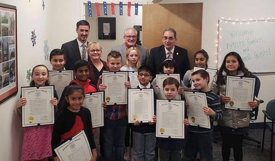 Students and teachers join Assemblyman Roy Freiman (far right in rear) during the art show.