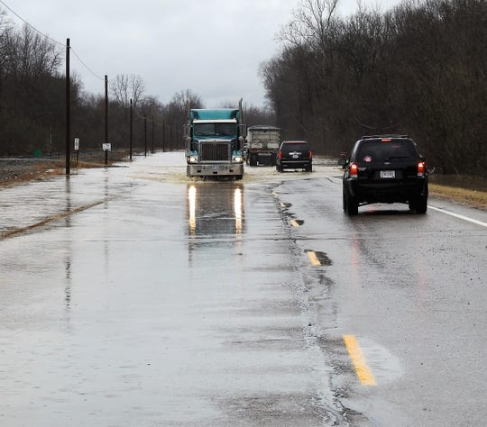 High water had traffic slowed about midday Tuesday on Ohio 16 between Conesville and Adams Mills. One lane was reopened late Wednesday morning. The entire road would reopen as the water subsided on Wednesday.