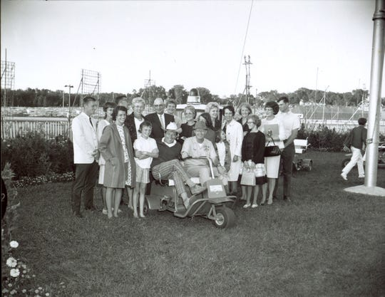 Andy Williams of Wall Lake, seated in a golf cart and wearing a white hat, meets with members of the Iowa State Fair Board in this undated photo.