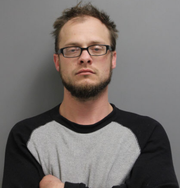 Jesse Joseph Poore, 31, of Cedar Rapids, is pictured in a previous mugshot. Poore was arrested Tuesday, Feb. 12, and charged with first-degree theft and assault of a police officer, among other charges.