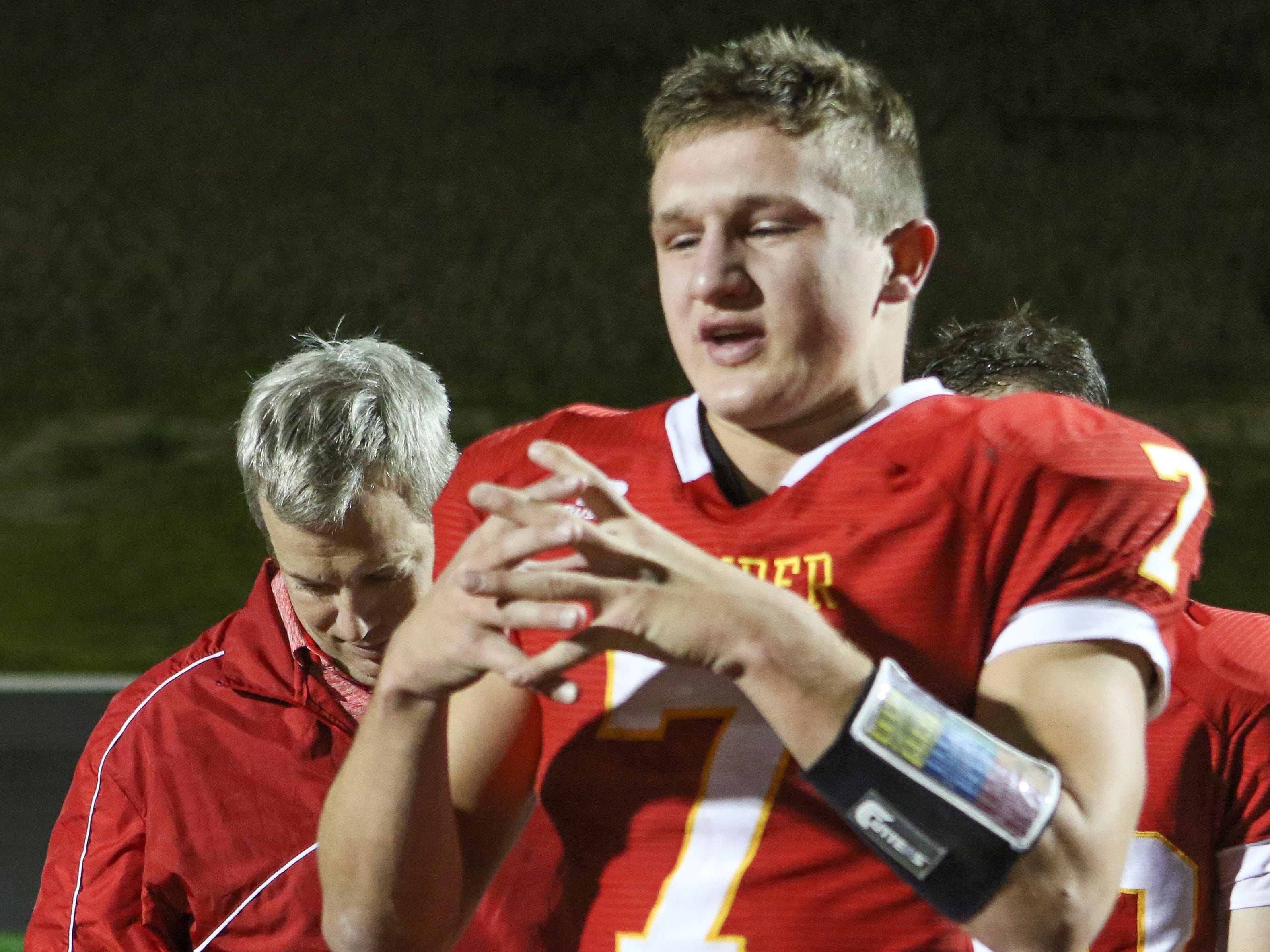 Gage Gunnerson playing football at Carroll Kuemper High School. Gunnerson, a four-sport standout at Kuemper, recently changed roles with the Iowa State University football team from manager to walk-on player.