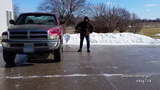 Ben Eichelberger of Muscatine saw he's completely iced-over driveway as a chance to slide into the day.