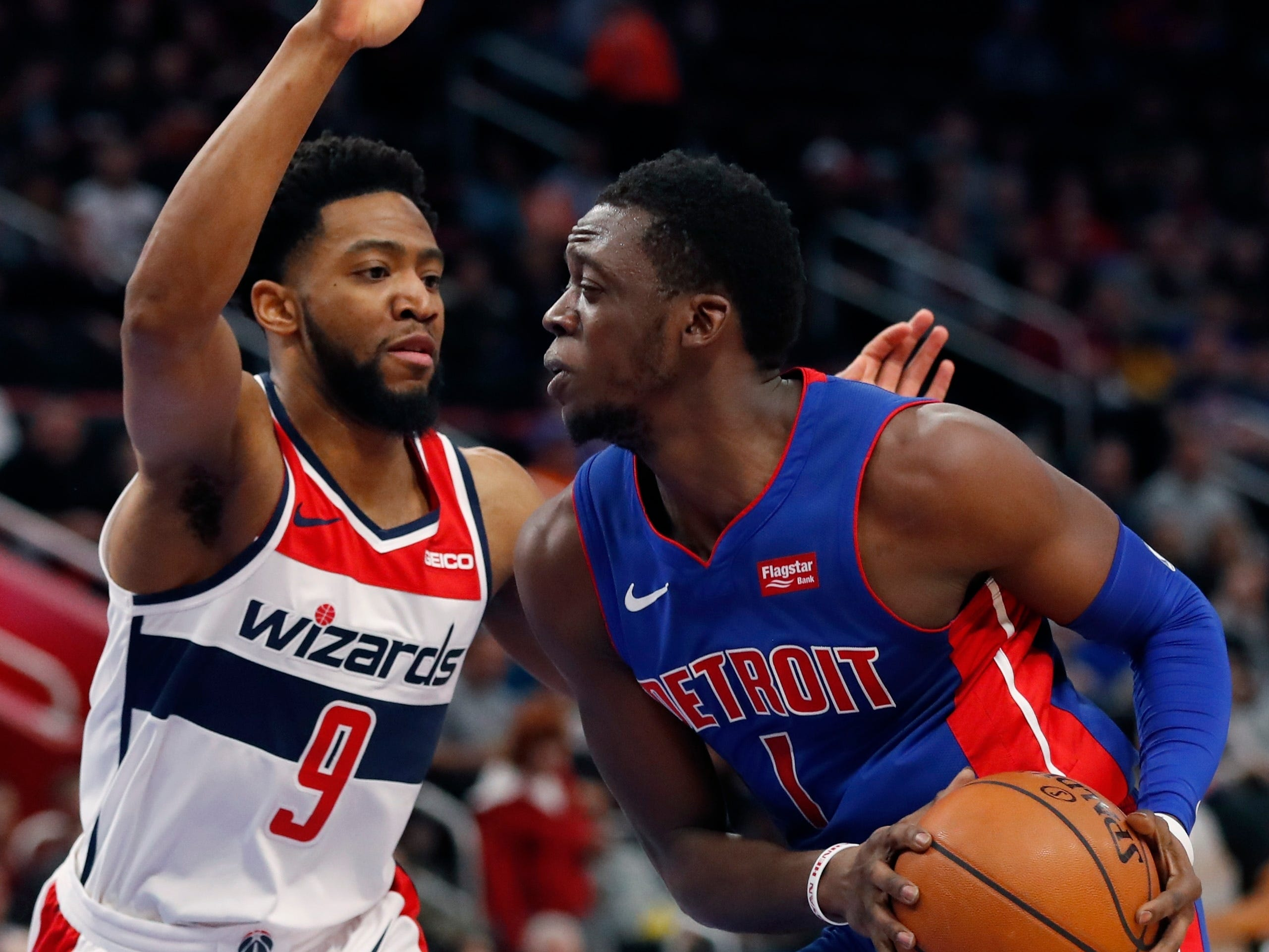 Detroit Pistons guard Reggie Jackson is defended by Washington Wizards guard Chasson Randle during the first half Monday, Feb. 11, 2019, in Detroit.