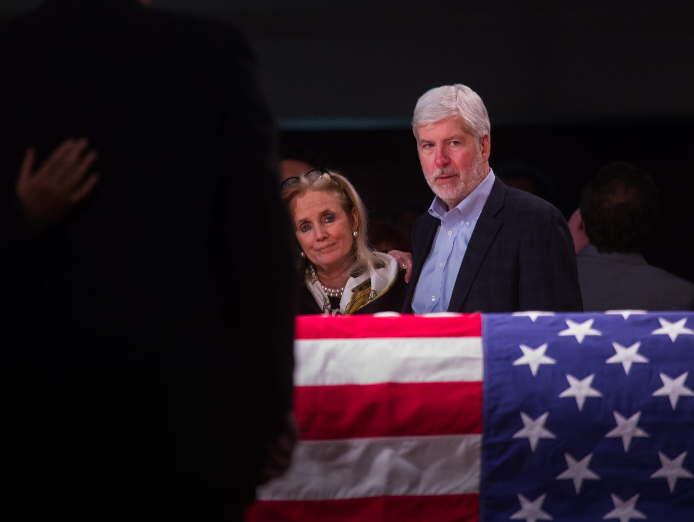 Former Governor Rick Snyder talks with Rep. Debbie Dingell during public visitation for her late husband former US Representative John D. Dingell at the Ford Community and Performing Arts Center in Dearborn on Monday, February 11, 2019.