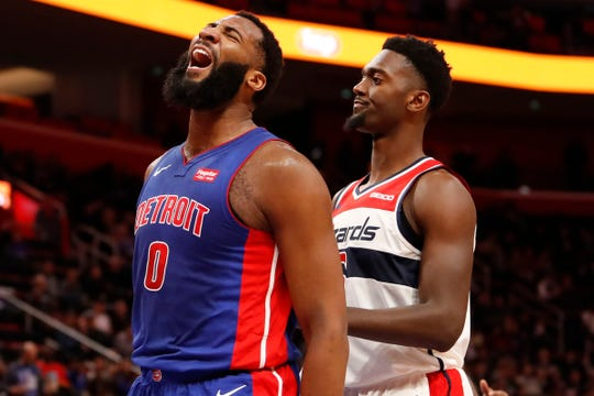 Detroit Pistons center Andre Drummond celebrates beside Washington Wizards forward Bobby Portis during the third quarter at Little Caesars Arena, Feb. 11, 2019.