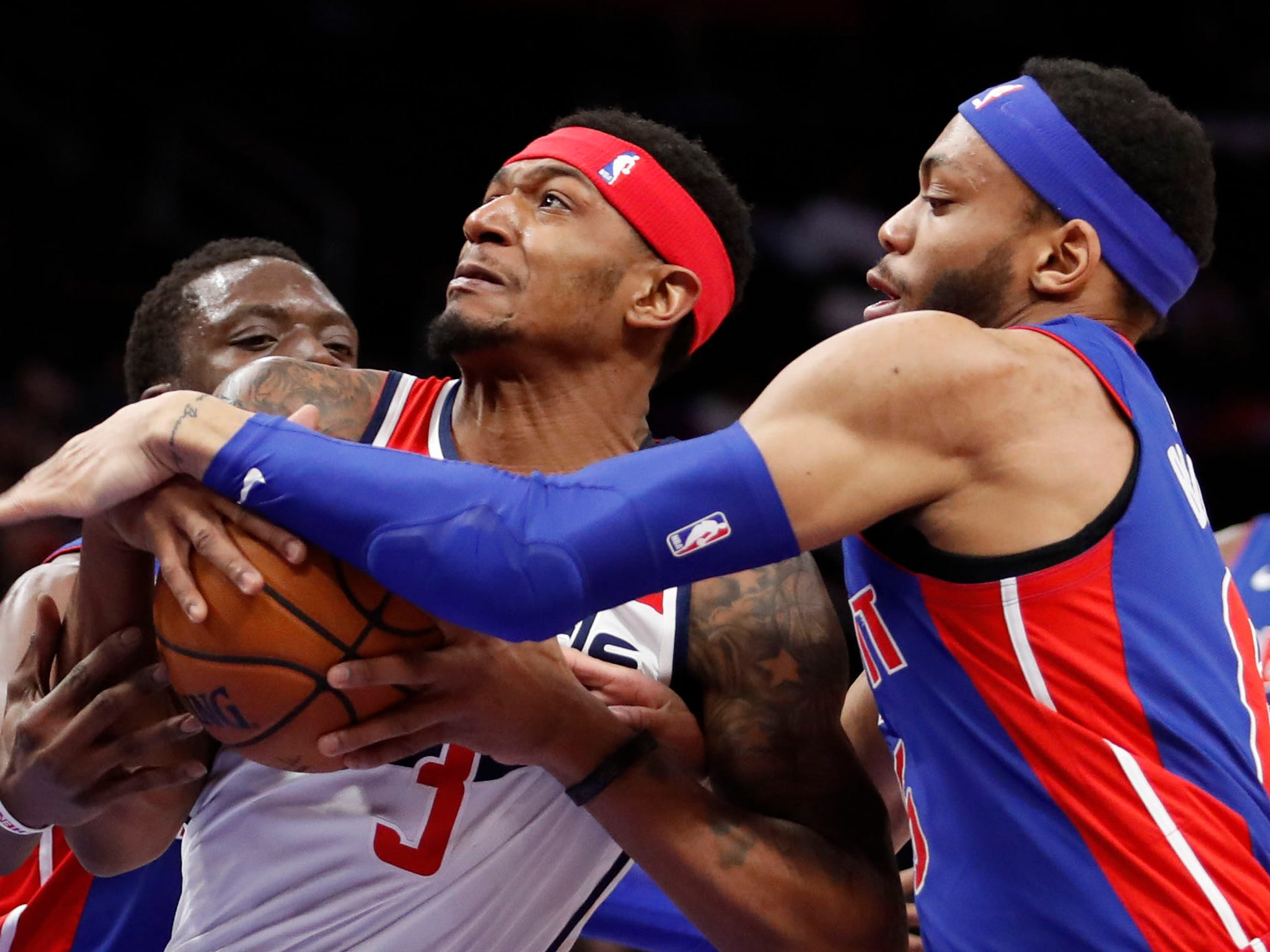Washington Wizards guard Bradley Beal is defended by Detroit Pistons guard  Bruce Brown, right, and Reggie Jackson, left, at Little Caesars Arena, Feb. 11, 2019.
