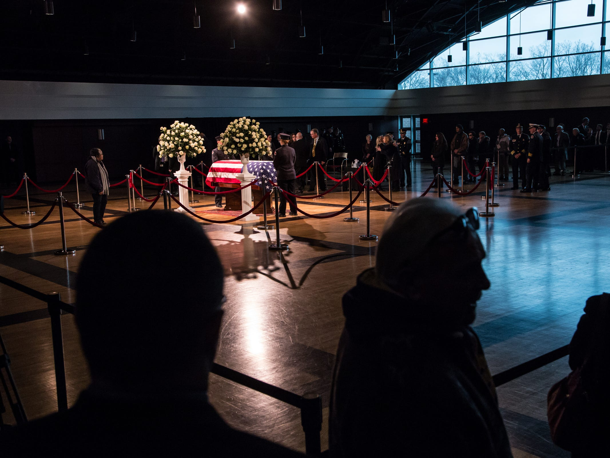People wait in line to pay their respects during the visitation for the former US Representative John D. Dingell at the Ford Community and Performing Arts Center in Dearborn on Monday, February 11, 2019.