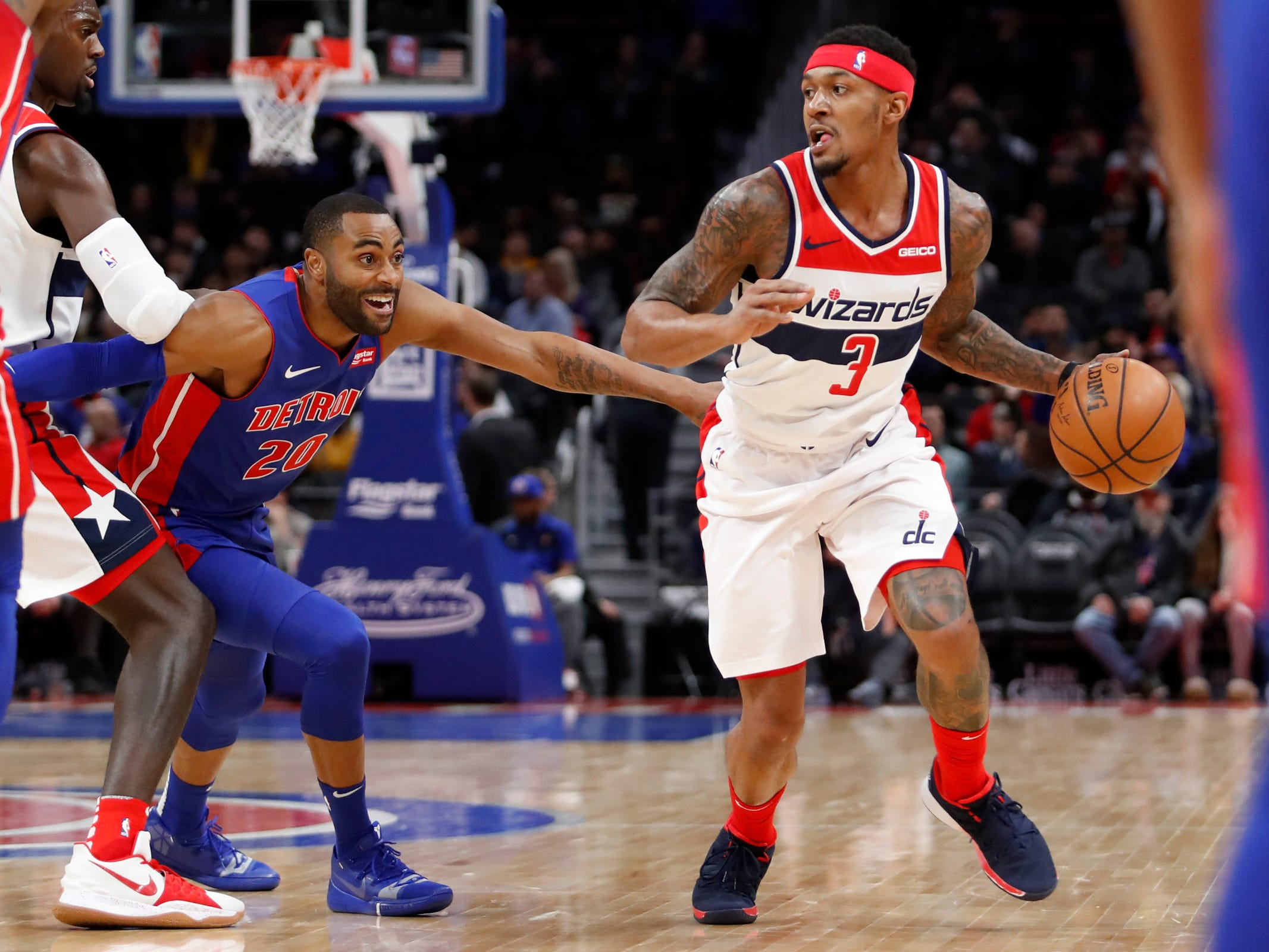 FWashington Wizards guard Bradley Beal handles the ball while defended by Detroit Pistons guard Wayne Ellington during the first quarter at Little Caesars Arena, Feb. 11, 2019.