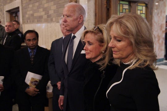 Rep. Debbie Dingell is joined by former Vice President Joe Biden for the funeral for the late former U.S. Representative John Dingell at Church of the Divine Child in Dearborn on Tuesday, February 12, 2019.