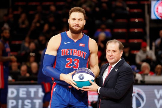 Blake Griffin is presented with a ball for being part of the NBA All-Star team by Detroit Pistons vice chairman Arn Tellem before the game against the Washington Wizards at Little Caesars Arena, Feb. 11, 2019.