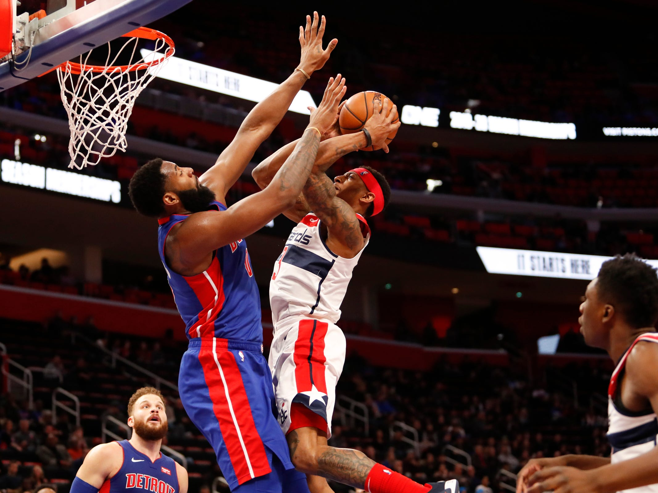 Washington Wizards guard Bradley Beal goes up for a shot against Detroit Pistons center Andre Drummond in the second quarter at Little Caesars Arena, Feb. 11, 2019.