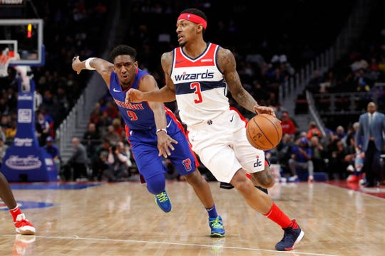 Washington Wizards guard Bradley Beal dribbles past Detroit Pistons guard Langston Galloway in the second quarter at Little Caesars Arena, Feb. 11, 2019.