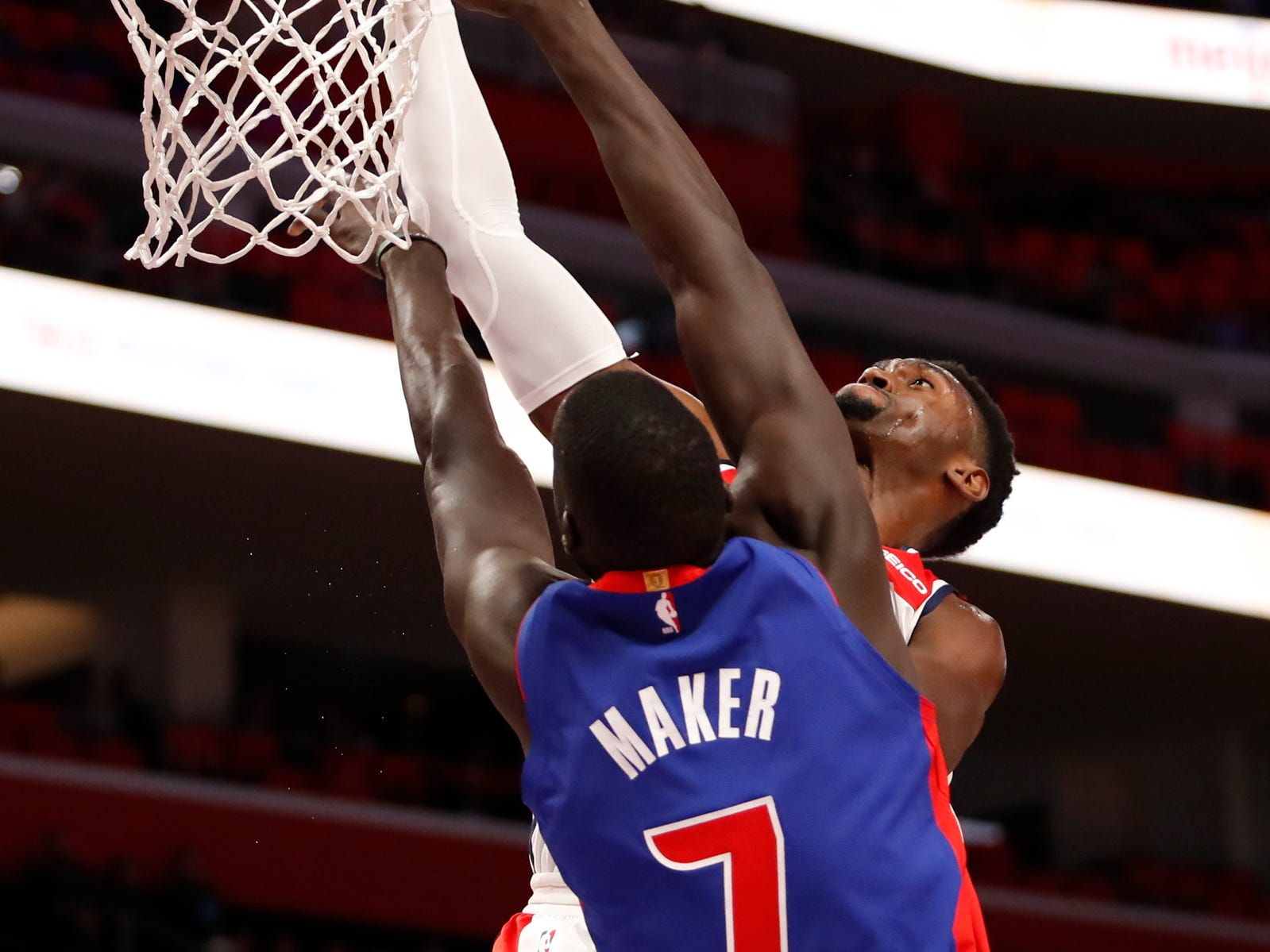 Washington Wizards' Bobby Portis has his dunk blocked by Detroit Pistons' Thon Maker in the first quarter at Little Caesars Arena, Feb. 11, 2019.