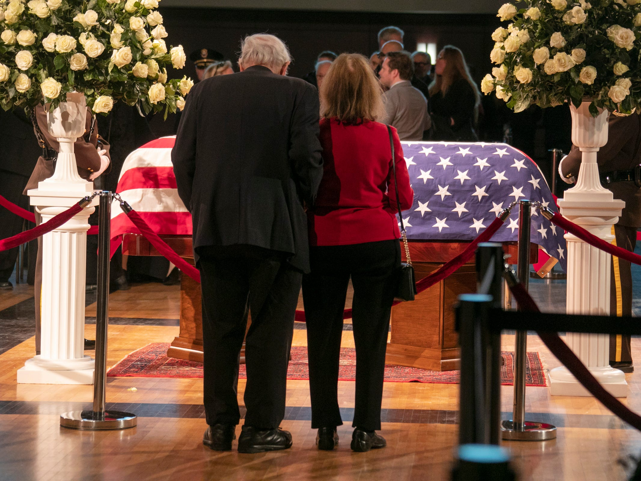 Carl Levin and his wife Barbara Halpern-Levin pay their respects to John Dingell who is lying in repose at the Michael A. Guido theater in Dearborn Monday, Feb. 11, 2019.