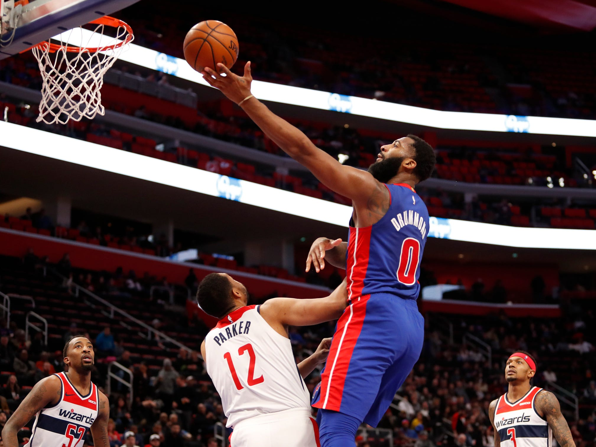 Detroit Pistons center Andre Drummond shoots over Washington Wizards forward Jabari Parker during the third quarter at Little Caesars Arena, Feb. 11, 2019.