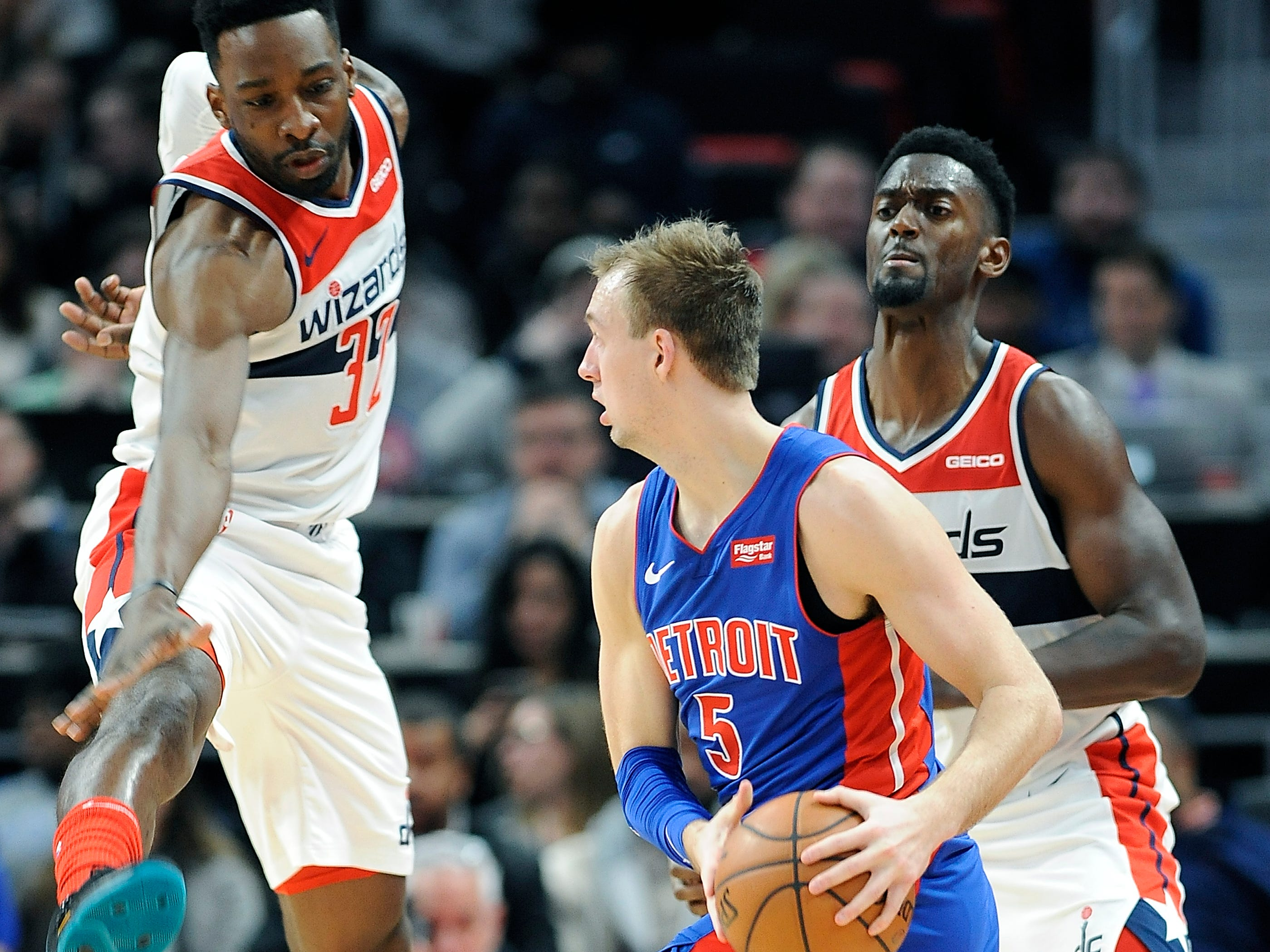 From left, Wizards' Jeff Green and Bobby Portis tries to trap Pistons Luke Kennard in the fourth quarter.