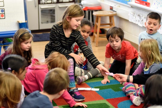 Gill Elementary kindergarten students work with their teacher to compile data to make a bar graph of the number and type of pets owned by them in their class, Monday, Feb. 11, 2019 in Farmington Hills, Mich.