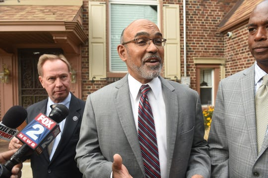 Wayne County Treasurer Eric Sabree speaks from outside his Detroit residence on Thursday August 31, 2017 as people carried signs in a peaceful protest outside his home in peaceful protest to ask Sabree to stop homes from being auctioned.
