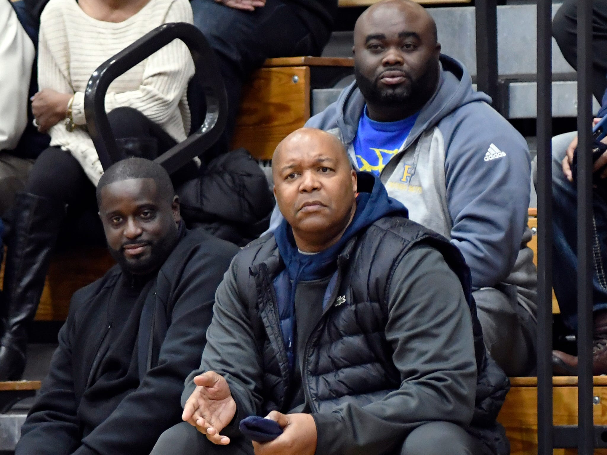 Former NBA basketball player Derrick Coleman, bottom foreground, who also played at Detroit Northern High School, watches King play Renaissance during the first quarter, Tuesday, Feb. 12, 2019, in a PSL boys basketball semifinal held at Cass Tech HS in Detroit.  Sitting behind Coleman is Wydell Henry, former head coach at Pershing but is now the head coach at Warren Lincoln.