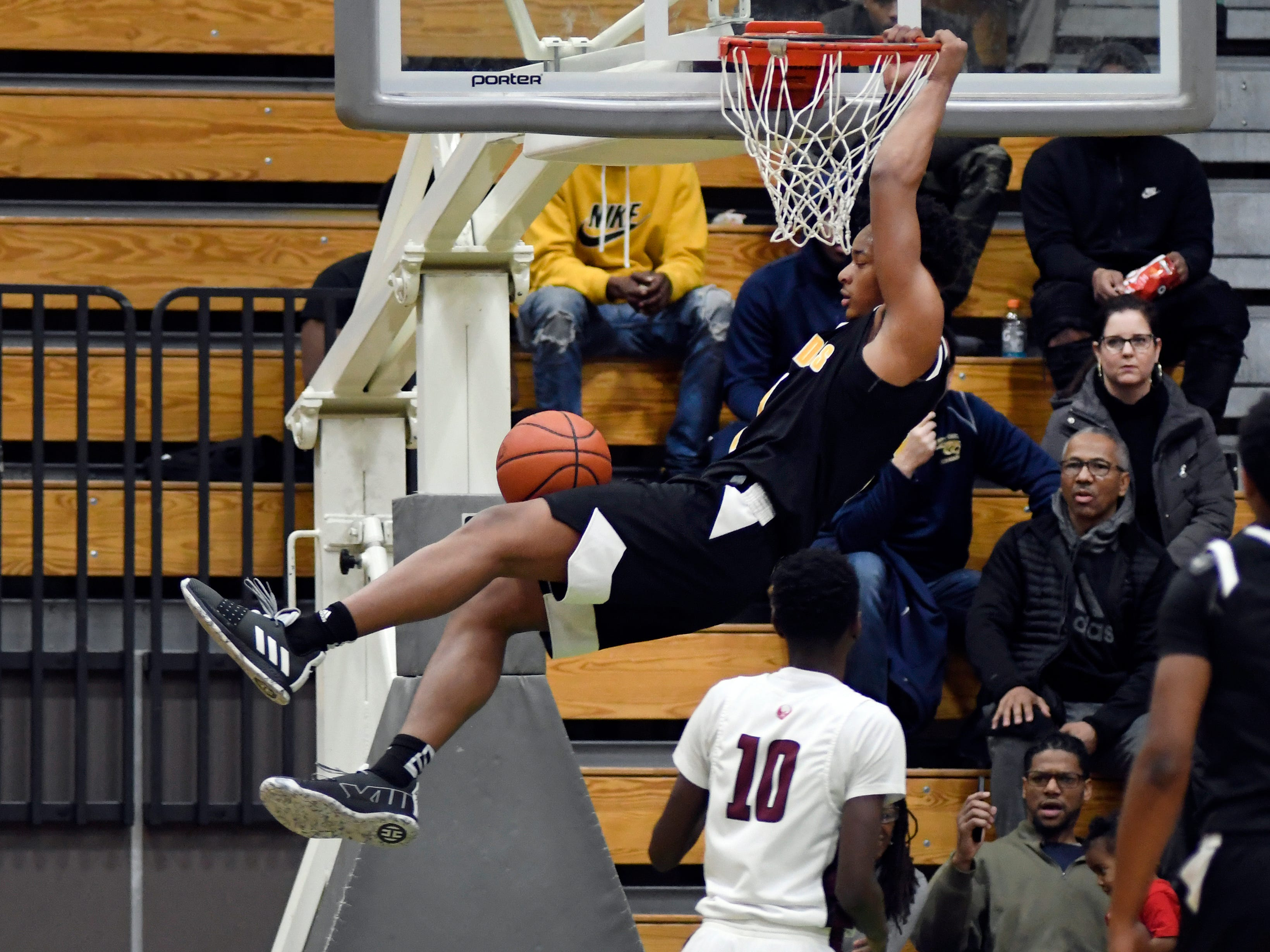Detroit King guard Omar Zeigler Jr. (1) dunks against Detroit Renaissance during the second quarter.