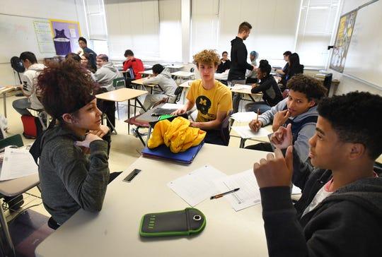 Teonna Garner, 14, Peyton Piccinini, 15, Mekhi Davis, 15 and Dreylon Johnson, 15, discuss a lesson during freshmen honors world history class at Madison High School in Madison Heights on Friday.