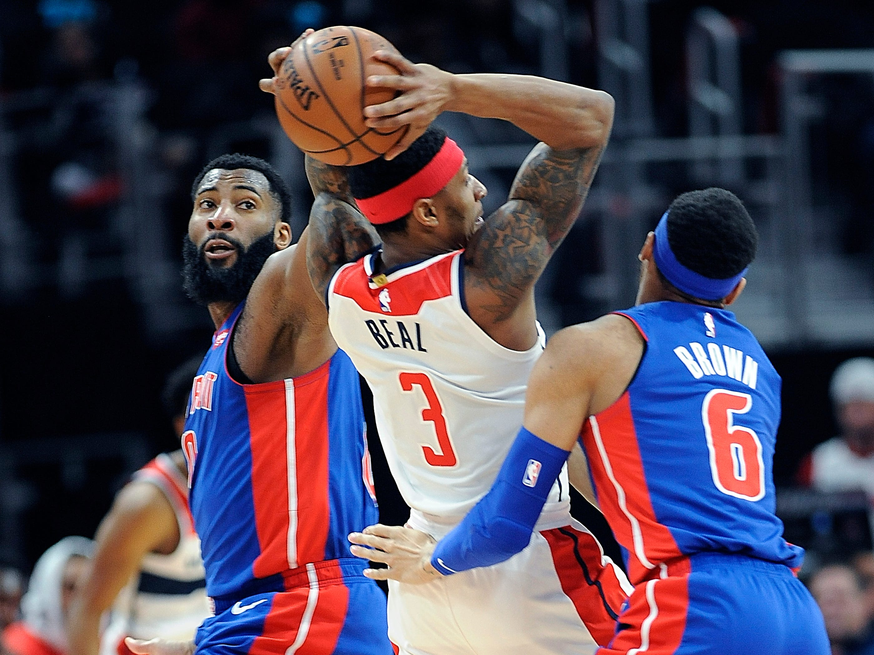 From left, Pistons' Andre Drummond and Bruce Brown double team Wizards' Bradley Beal in the second quarter.